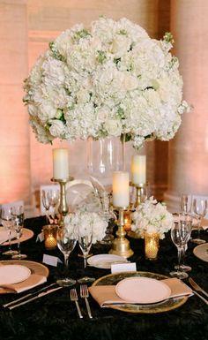 Photographer: U Me Us Studios; Wedding reception centerpiece idea;
