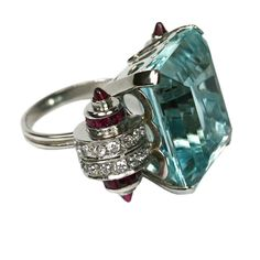 Cartier Art Deco aquamarine, diamond, ruby ring - side view.