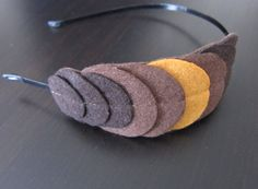 """Felted headband (not elastic) - this would be great for the girls. . . make with """"girly"""" shapes and colors."""