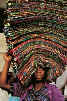 Carrying fabric to the market to sell.