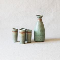 Turquoise sake serving set hand thrown by Skyler Bolton. Sake cups approximate measurements are 3 to 4 inches height with a inch diameter. Sake bottle approximately measures 6 to 7 inches in height with a 1 inch spout.
