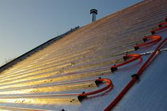 How to build an integrated solar electric + solar hot water metal roof without breaking the bank