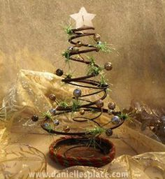 "Rusty Prim ""Bed Spring"" Christmas Tree - 32 Astonishing DIY Vintage Christmas Decor Ideas"