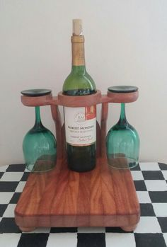 This is a custom made all in one wine holder, glass holder and cutting board for cheese and crackers that I designed for resale