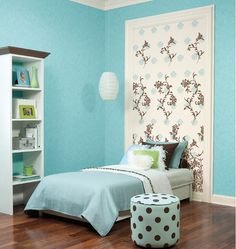 Dreamy bright blue girls bedroom with awesome wallpaper feature.  www.WallpaperWholesaler.com now offers over 200,000 styles of wallpaper at wholesale prices online!