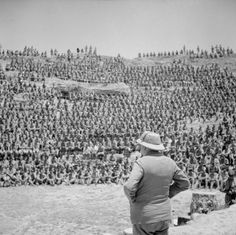 The Prime Minister Winston Churchill addresses British troops in the old Roman amphitheatre at Carthage, Tunisia, on 1 June 1943.