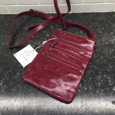 Shiraleah Chicago Harper Cross Body Pouch Brand new- with tags never used. Gorgeous berry color, 3 front zip pockets and a beautiful flower lining. Shiraleah Chicago Bags Crossbody Bags