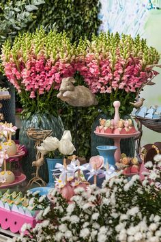 Batizado e festa de 1 ano da Bela com tema jardim.   Decoração em rosa, lilás, azul bebê.  Local: Fazenda Vila Rica Assessoria: Dani Macek Bolo: Piece of cake Recreação: Fadas Madrinhas Música: DB2 Produção