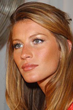 Gisele Bundchen- bronze skin, shimmery lips, blonde hair- darker underneath and lighter on top.
