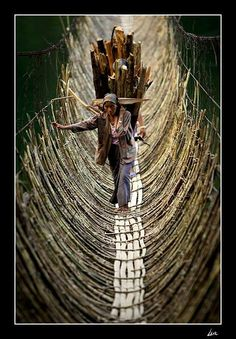 Carrying the Burdens of Life -  Cane bridge in the village Kabua , Republic Of The Congo.