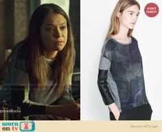 Sarah's grey printed front top with leather sleeves on Orphan Black.  Outfit Details: http://wornontv.net/32731/ #OrphanBlack