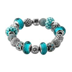 PANDORA Gypsy Teal Charm Bracelet - This PANDORA Gypsy Teal Charm Bracelet is the perfect addition to your wardrobe for the summer! This bracelet is sure to add a splash of tropical teal heaven to any outfit! This bracelet features teal murano glass and cubic zirconia on an oxidized sterling silver chain.