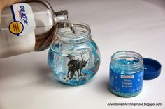 Easy FROZEN snow globes with stickers, glitter and mineral oil. #FrozenFun #shop #cbias