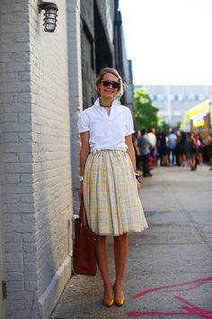 Another pretty skirt. That simple knotted white shirt cinches the look.