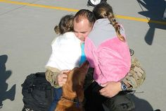 RALEIGH, N.C. –Army Chief Warrant Officer 4 Ty Mullins is welcomed home by his family after more than eight months deployed to Afghanistan. Mullins and other members of the North Carolina National Guard's Morrisville-based Operational Support Airlift Command Detachment 17 returned to North Carolina here today, Nov. 21, just in time for the Thanksgiving holiday.