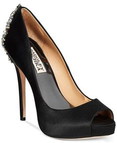 The dramatic jeweled details on the heel of the Kiara evening pumps are sure to turn some heads. By Badgley Michka.   Imported   Satin upper   Round peep-toe platform evening pumps with embellished de