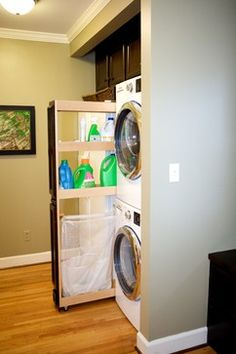 double cabinet for stacked washers and dryers with storage and laundry bag