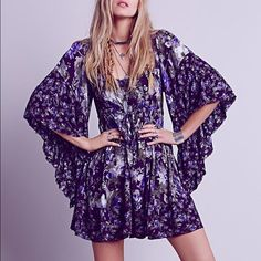 Free People Flowy Purple Dress Worn only one time, so it is in next to brand new condition. It has the cutest sleeves and an adorable pattern! Let me know if you have any further questions  Free People Dresses