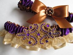 This gorgeous Bridal Wedding Garter is gathered in regal purple satin and sheer, shimmery gold organza ruffles and adorned with a purple jeweled rhinestone applique. #timelesstreasure