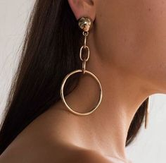 Style Tip: Try wearing just one statement gold earring for a cool, asymmetrical look