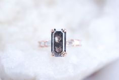 Salt and Pepper Emerald Diamond Engagement Ring with Baguette Diamond Side Stones Baguette Engagement Ring, Emerald Cut Engagement, Diamond Engagement Rings, Emerald Diamond, Diamond Rings, Baguette Diamond, Pepper, Salt, Stones
