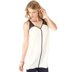 This oh-so-pretty white/ivory tunic has black lace at the shoulders and a slimming black seam along the center. Features black see-through lace shoulder shade-like triangles that mirror on the back, and reverse satin binding. Relaxed fit that falls below the hip.; Body: 100% Polyester; Lace: 100% Nylon; Length from highest point / shoulder: 27; (medium); 30; (2X);
