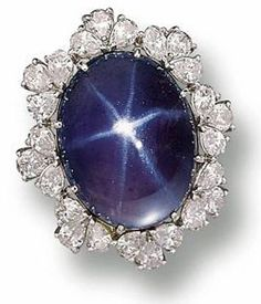 The Gordon Star Sapphire: The oval-shaped star sapphire cabochon weighing approximately 52.00 carats, framed by 24 pear-shaped diamonds weighing approximately 6.60 carats is named after the Gordon's Jewelers family which operates of 600 stores. The Gordon Star Sapphire sold to a private party in 2,002 through Sotheby's Auction House.