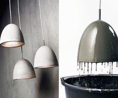 comprar una lámpara barata, se moja en cemento, se conecta un cable de color y pinta el interior con el mismo color que el cable