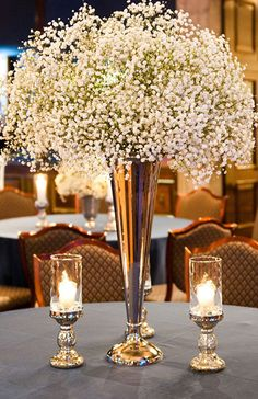 A big bunch of Baby's Breath will look pretty in the milk glass vases.