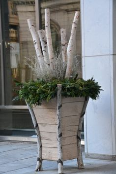 Winter Urn |  Large scale contemporary birch  faux bois concrete planter | Birch poles, white lepto, mixed evergreen