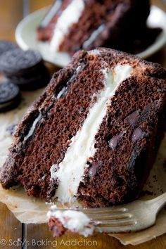 Oreo Layer Cake: complete with a thick Oreo cream filling, chocolate frosting, and two layers of Oreo Cookies - a chocolate lovers dream.