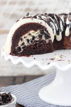 Stop drooling and start eating this Oreo Chocolate Cheesecake Cake. A dark choco… Stop drooling and start eating this Oreo Chocolate Cheesecake Cake. A dark chocolate bundt cake layered with an Oreo cheesecake and covered in a chocolate cheesecake glaze. Oreo Cheesecake, Chocolate Cheesecake, Cheesecake Recipes, Christmas Cheesecake, Pumpkin Cheesecake, Raspberry Cheesecake, Chocolate Bundt Cake, Oreo Cake, Brownie Cake