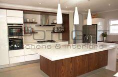 Spotlight Kitchens Walnut veneer and white high gloss with caeserstone worktops
