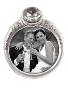 Wedding Ring Picture Frame  http://www.giftamillion.com/wedding-ring-picture-frame.html