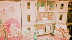 such a cute idea, using a doll house for the desert table
