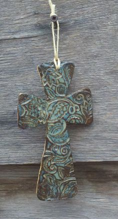 Stamped slab, cut out cross. Hand Built Pottery, Slab Pottery, Ceramic Pottery, Pottery Art, Pottery Ideas, Ceramic Jewelry, Ceramic Clay, Ceramic Beads, Clay Jewelry