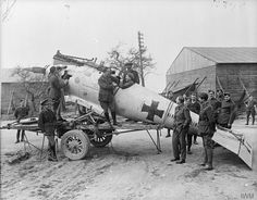 Officers of No. 59 Squadron RAF examining the fuselage of a German Pfalz Scout D.III at Vert Galand Aerodrome, 26 April 1918
