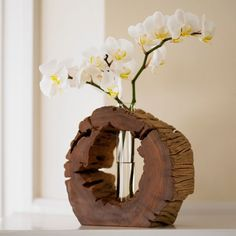 Crafted in the Philippines from found, reclaimed wood, this beautiful, recycled glass vase is an eye-catching work of art even before you fill it with a bud or a bloom.  Check It Out Here >> http://jdtc.us/1KiZ7gw