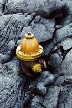 Fire hydrant frozen in time by lava rock erupted from Kilauea volcano -- Hawaii.