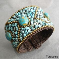 @Overstock.com - Cotton Rope Coral/ Quartz/ Lapis/ Turquoise Brass Wire Cuff (Thailand) - This cuff features an oval design with the stones and brass sewn on cotton wax rope. Handmade in Thailand by artisan, Jeab, this bracelet can adjust to wrists of many sizes.  http://www.overstock.com/Worldstock-Fair-Trade/Cotton-Rope-Coral-Quartz-Lapis-Turquoise-Brass-Wire-Cuff-Thailand/5707978/product.html?CID=214117 $33.99