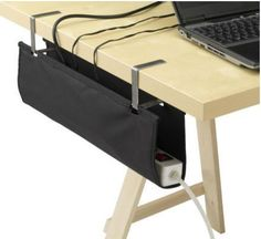 Signum Cable Organizer ($5, Ikea) hangs from the ends of your desk or TV bench to stash surge protectors and extra cables out of sight and out of mind.