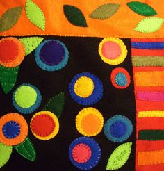 WOW! I love this, love the colors and circle flowers and leaves :). LOVE!  I think it would work up just fine with fleece applique. sara's art* house: still more felt