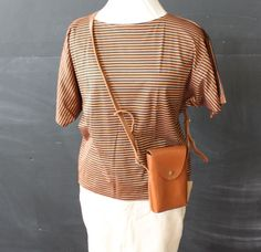 beautiful tan leather case/bag by cheapopulance on Etsy, $25.00