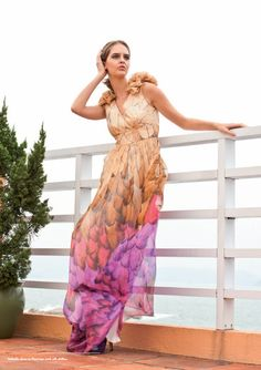 https://www.cityblis.com/item/2368  Isabella - $584 by By Malina  Isabella is a full-length dress in 100%  silk chiffon. Overlapped body with ruffle detail on top of shoulder. Isabella is available in Laguna, Malibu Coral, Malibu Pink, Flamingo Pink, Zuma. And one-coloured Coral, Mint, Hyacint, Powder, Petrol, Rasberry, Nude and Black. Dry clean recommended but...