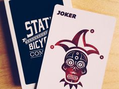 This State Bicycle Co. deck of playing cards is a perfect gift for any State Bicycle enthusiast. This deck of cards boasts the classic State ribbon logo with a green backdrop.