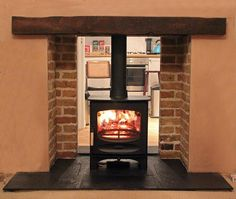 @Charnwood C5 #woodstove in double sided fireplace with reclaimed brick slip chamber, slate hearth and oak beam pic.twitter.com/3zd2TJHrtn