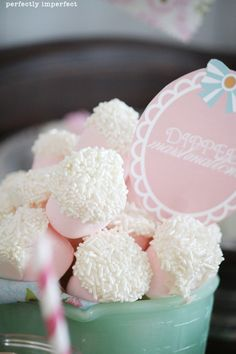 Strawberry marshmallows dipped in white candy melts and rolled in sprinkles.