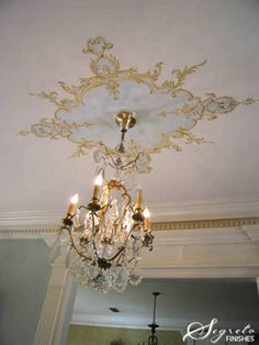 Handpainting medallions around chandeliers is a wonderful way to customize the space and add personality – so much more so than a plaster-applied medallion. ~segretosecrets.squarespace.com