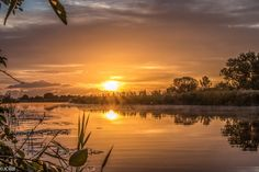Sunrise reflecting in water by Wilco van der Laan Fotografie on 500px