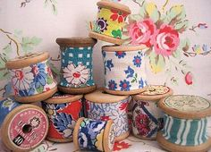 Vintage fabric on spools...awesome! Now I know why I bought that bag of old wooden spools in LB...